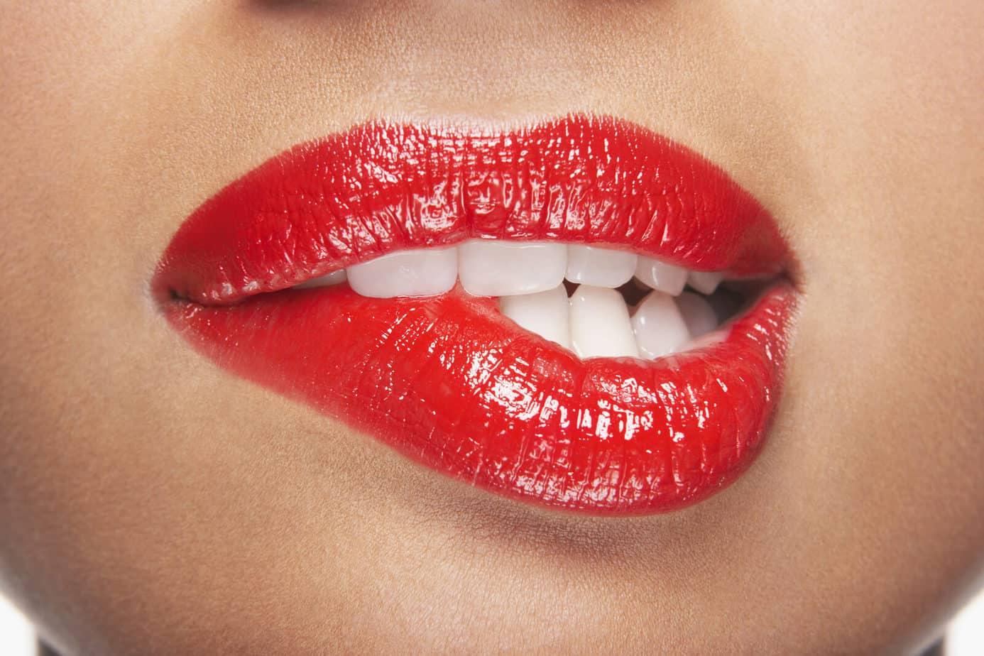 Why do girls bite their lips