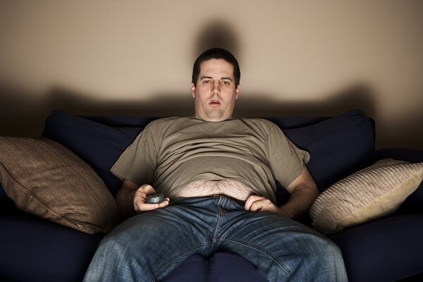 Overweight Man Watching Tv